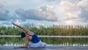 Asian woman practicing yoga pose Royalty Free Stock Photo