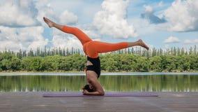 Asian woman practicing yoga pose Stock Photography