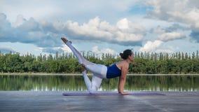 Asian woman practicing yoga pose Stock Photo