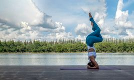 Asian woman practicing yoga pose Royalty Free Stock Images