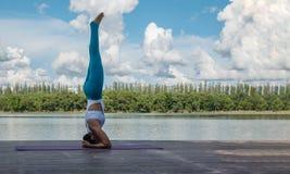 Asian woman practicing yoga pose Royalty Free Stock Photos