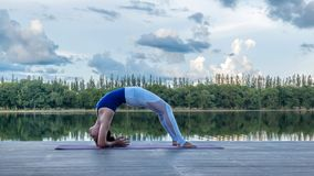 Asian woman practicing yoga pose Royalty Free Stock Photography