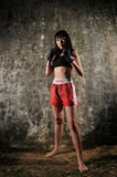 Asian Woman Practising Muay Thai Boxing Stock Image
