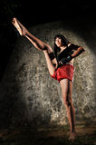 Asian Woman Practising Muay Thai Boxing royalty free stock photos