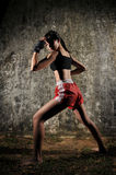Asian Woman Practising Muay Thai Boxing Stock Photo