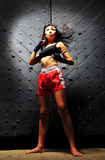 Asian Woman Practising Muay Thai Boxing Royalty Free Stock Photography