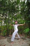 Asian Woman practising Yoga in Woods 2 Royalty Free Stock Photos