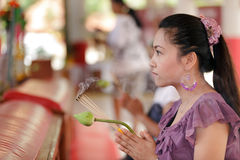 Asian woman praying Royalty Free Stock Images