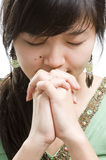 Asian woman praying. Asian woman saying a prayer Stock Images