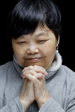 Asian woman praying and praising the Lord Stock Image