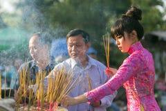 Asian woman praying at temple Stock Photo