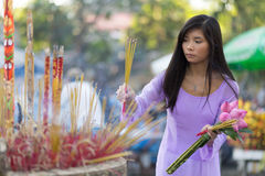 Asian woman praying at temple Stock Images