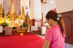 Asian woman praying to Buddha Stock Photo