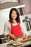 Asian Woman Preparing Food in Kitchen Royalty Free Stock Photo