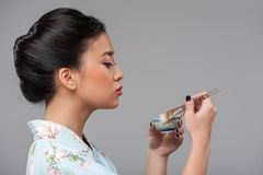 Asian woman preparing tea ceremony Royalty Free Stock Photo