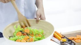 Asian woman is preparing vegetables to make a salad for lunch stock footage