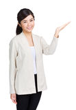 Asian woman present Stock Photography