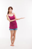 Asian woman present something. Royalty Free Stock Images