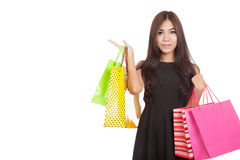 Asian woman  present something  with shopping bags Stock Photography