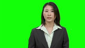 Asian woman presenting on Green Screen. TV media, anchor concept stock footage