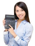 Asian woman press the calculator Stock Images