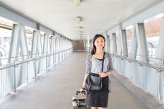 Asian woman pull luggage stock photography