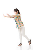 Asian woman pushing or leaning on wall Royalty Free Stock Image