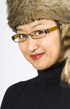 Asian Woman with a Raccoon Hat Royalty Free Stock Photography