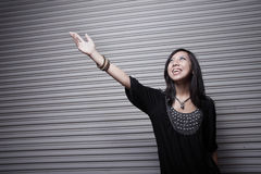 Asian woman reaching for the light Royalty Free Stock Photography