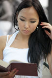 Asian woman read Stock Photos