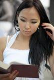 Asian woman read Stock Photos