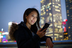Asian Woman read on text message on phone Royalty Free Stock Photo