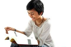 Asian woman reading Stock Images