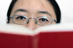 Asian woman reading a book Stock Photography