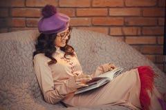 Asian woman reading book indoors Royalty Free Stock Photos