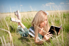 asian woman reading book on a nature Royalty Free Stock Image