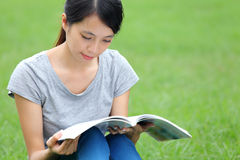 Asian woman reading book Royalty Free Stock Image