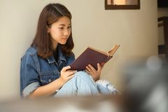 Asian woman reading a book vintage style. Stock Photography
