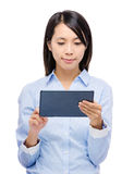 Asian woman reading on digital tablet Stock Images