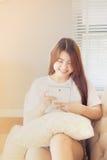 Asian woman reading e-book Royalty Free Stock Photos