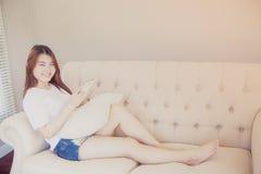 Asian woman reading e-book Stock Photography