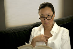 Asian Woman Reading Stock Photo