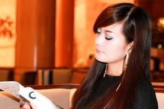 Asian woman Reading magazine. At the lobby Stock Photos