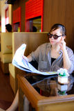 Asian woman reading newspaper Royalty Free Stock Image