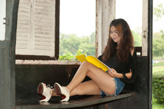 Asian woman reading in old train room . Royalty Free Stock Photo