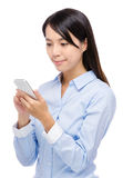 Asian woman reading something on phone Stock Images