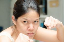 Asian woman ready to fight guarding with empty hand Stock Images