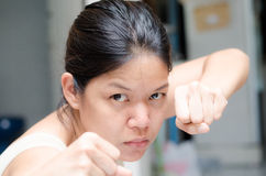 Asian woman ready to fight guarding with empty hand Stock Photo