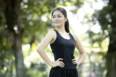 Asian woman ready to go cross country running. Royalty Free Stock Photo
