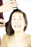 Asian woman ready to shave her hair smiling Royalty Free Stock Image